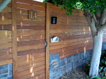 Fence & swing gate onto low brick wall (Colortone Woodseal)
