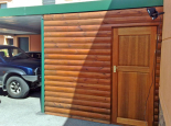 Enclosed carport with loglap walls