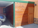 Enclose part of your existing carport with loglap walls